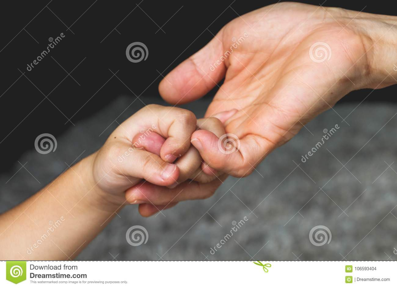hands old holding and young